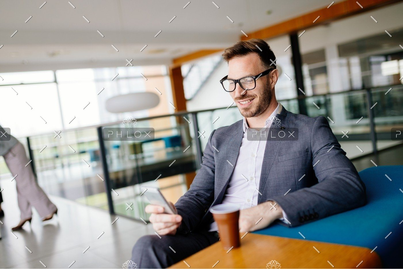 demo-attachment-657-businessman-taking-a-break-with-a-cup-of-coffee-JW4B3DH