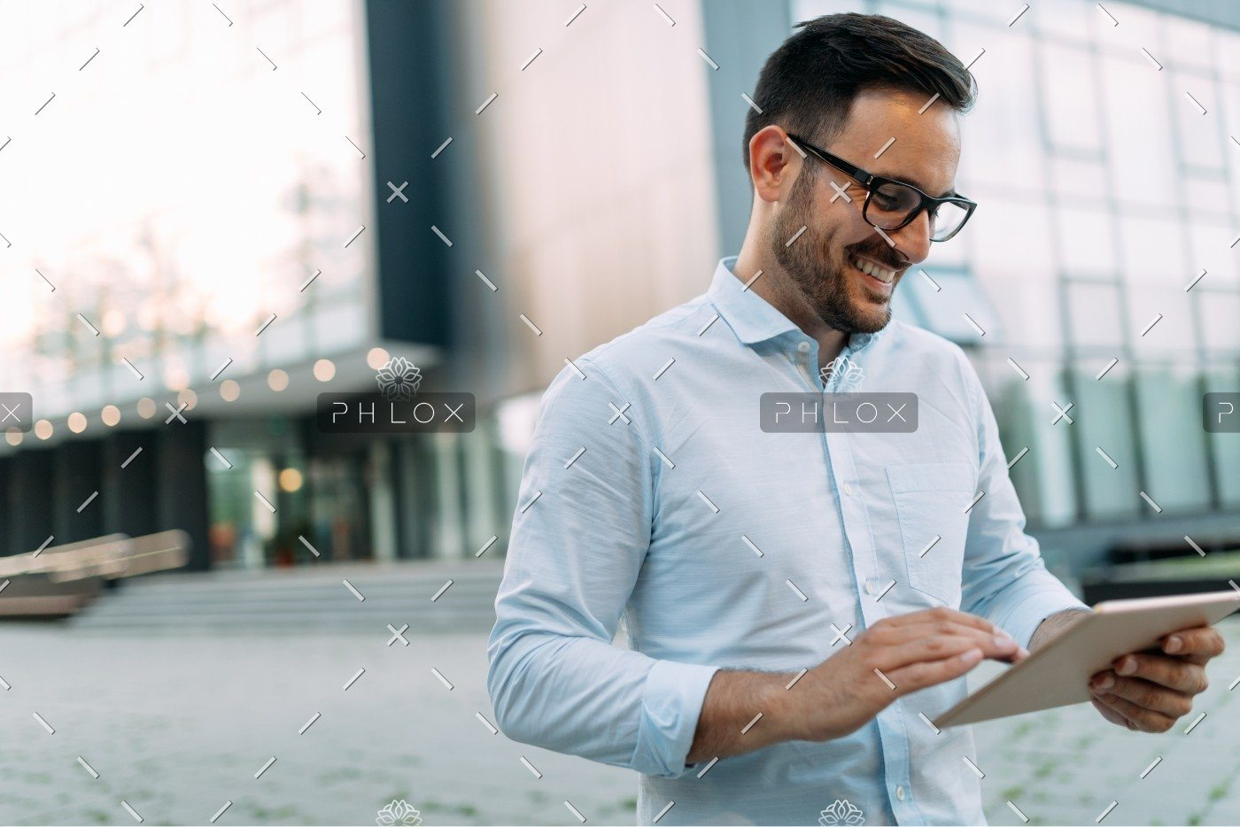 demo-attachment-336-portrait-of-businessman-in-glasses-holding-tablet-AWVHCJU